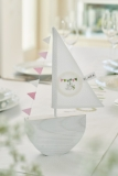 wooden boat with pink paper banners